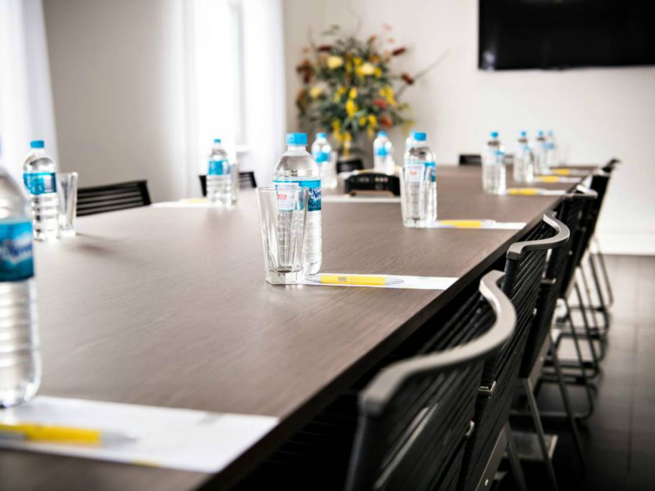 Meeting Table With Bottles Of Water, Ready For A Team Meeting.