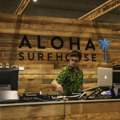 A Dj Playing Music Inside The Surfhouse