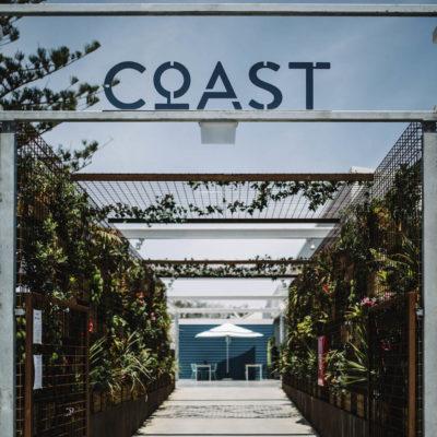The Entrance Sign For The Coast Port Beach.