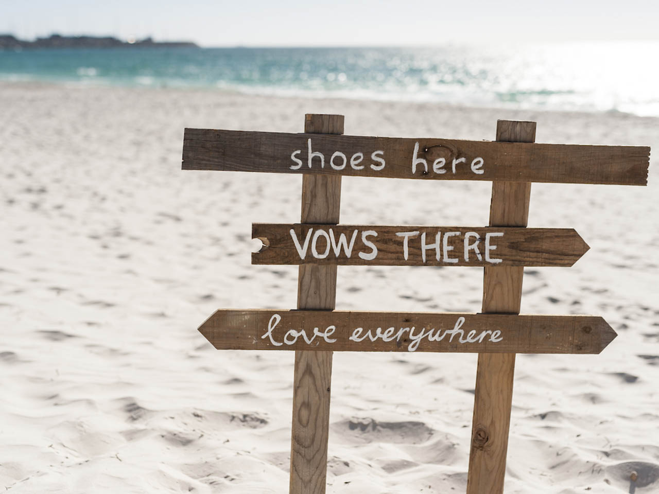 A Sign That Says Shoes Here, Vows There, Love Everywhere.