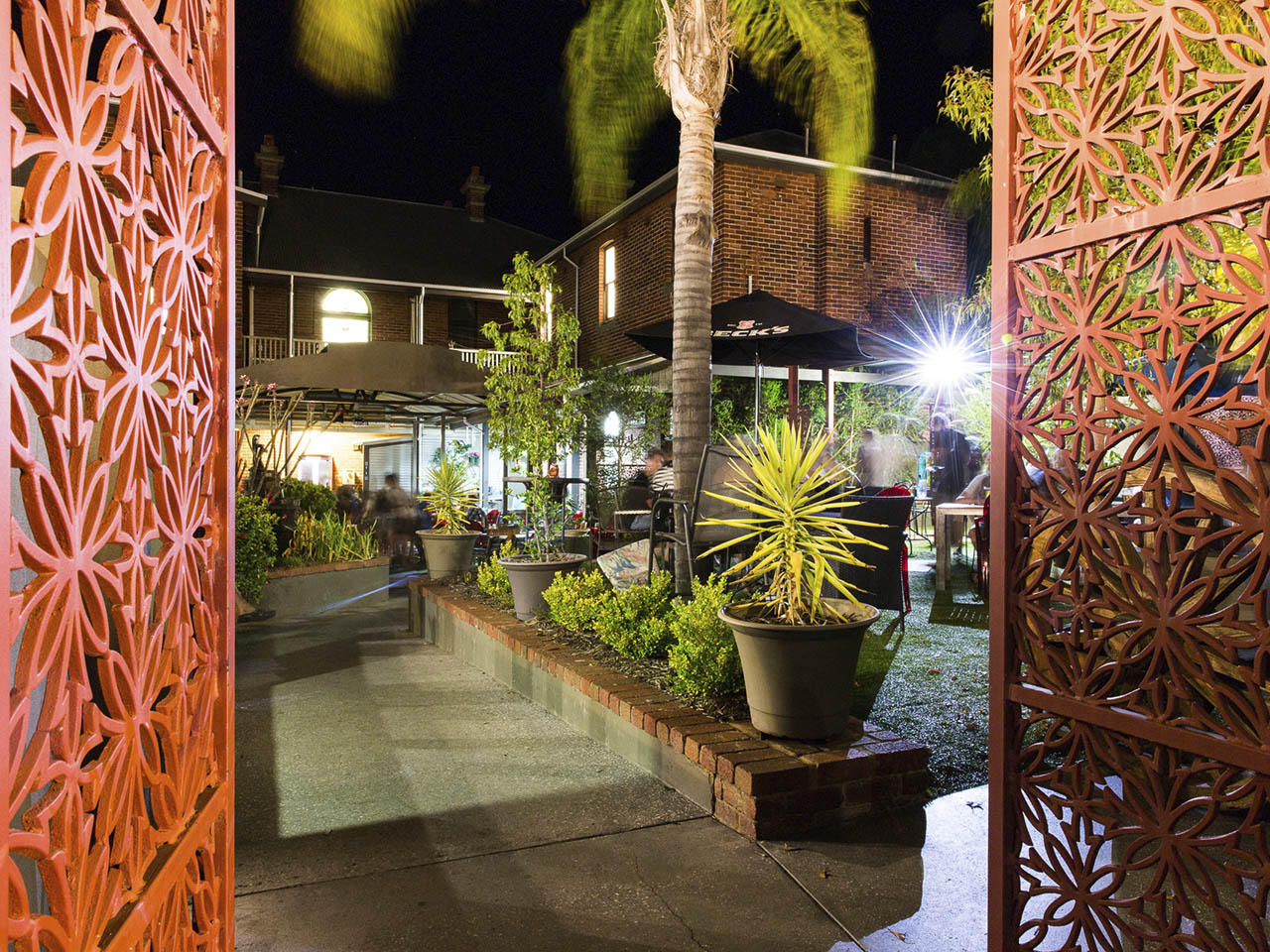 Garden Bar with Plants and Coco Tree and Dukes Inn's Building Behind