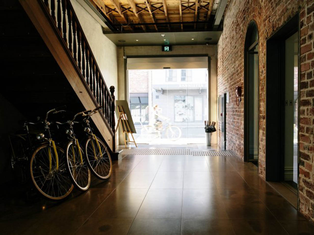 Brick Retro Entrance With Bike Leaned Against The Wall.