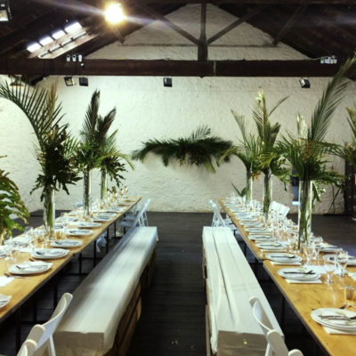 Tables Set Up In A Gallery And With Plants