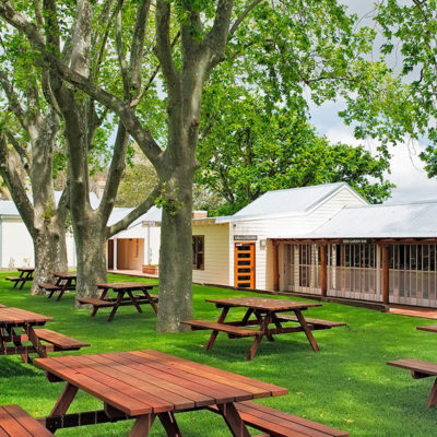 Wood Table With Chairs Attached Outside The Function Room Under The Trees