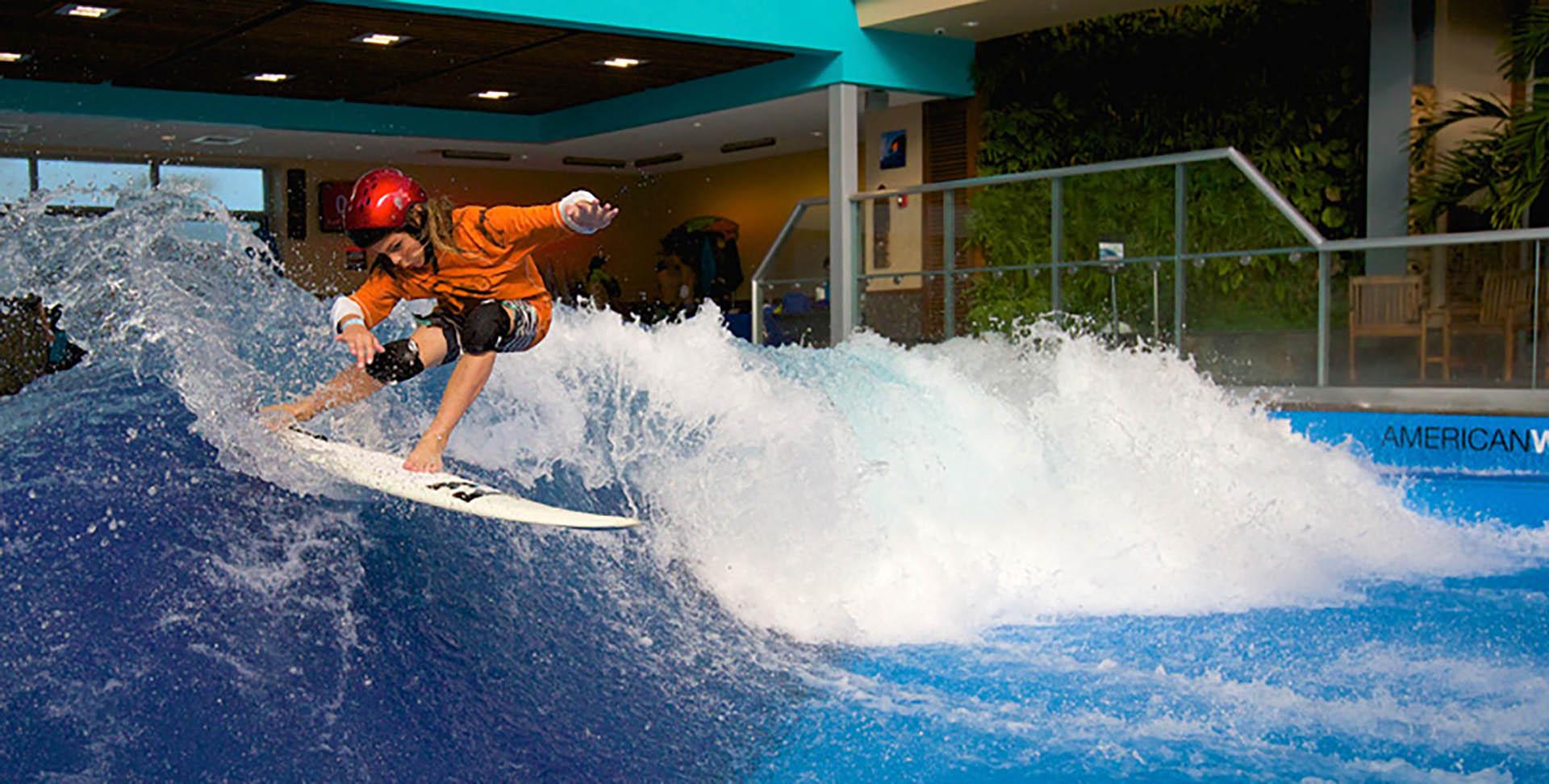 A Surfer On a Wave Inside The Surfhouse