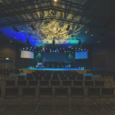 Auditorium With A Stage And Seating.