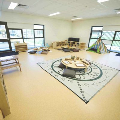 Community Room With Pale Floors And Seats.