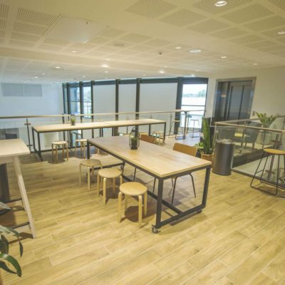 Open Plan Meeting Space For Hire With Tables And Chairs.