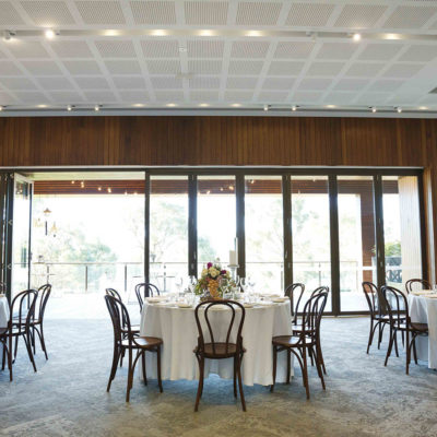 White Round Tables With Table Toppers And Big Windows.