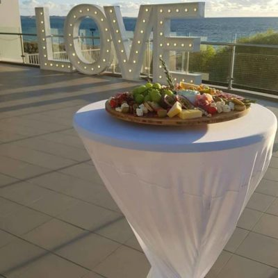 A Food Platter With A View Of The Ocean.