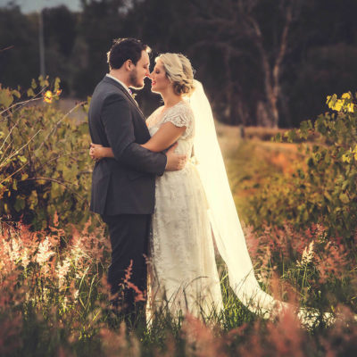 Wedding couple in field celebrating their marriage