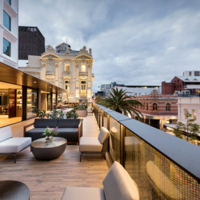 Beautiful Rooftop Balcony Overlooking Elegant Buildings.