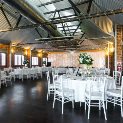 Tables And Chairs Set Up In A Large Function Room For A Wedding.