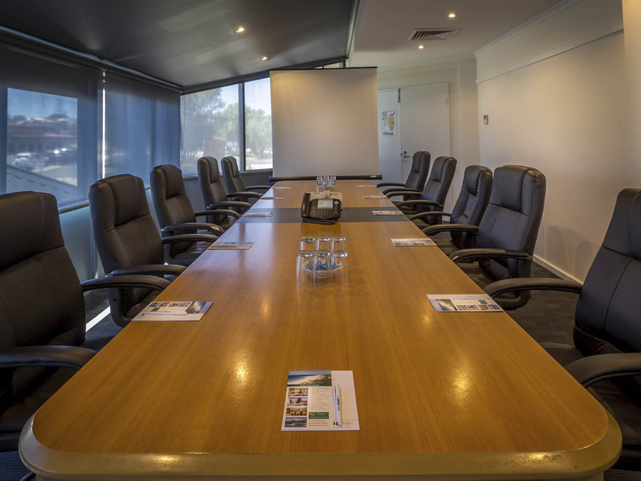 Coporate Meeting Room With Grey Chairs.