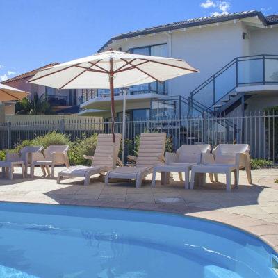 The Pool With A Sun Umbrella.