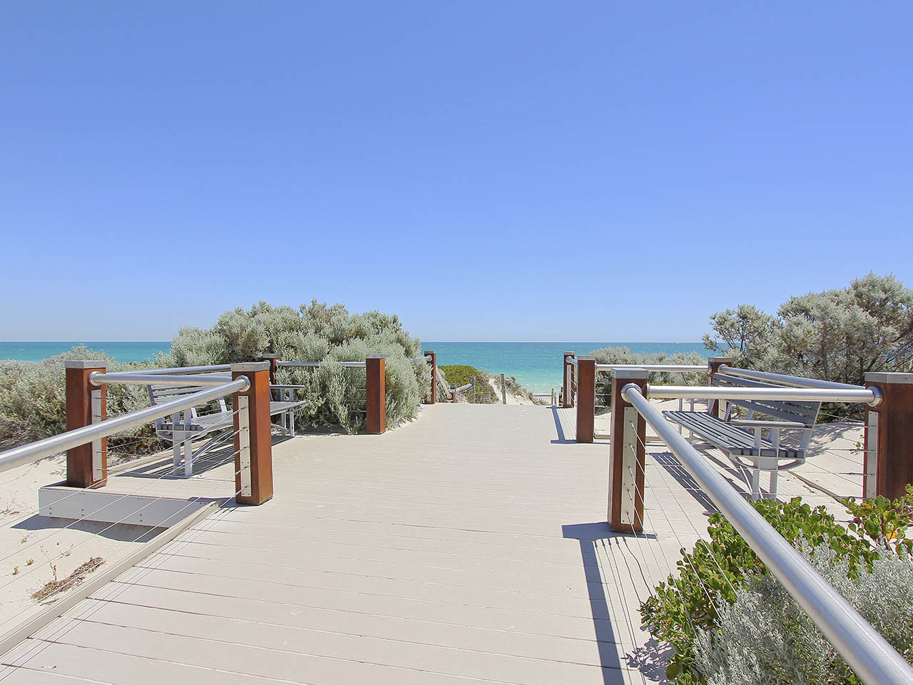 A Board Pathway To The Beach.