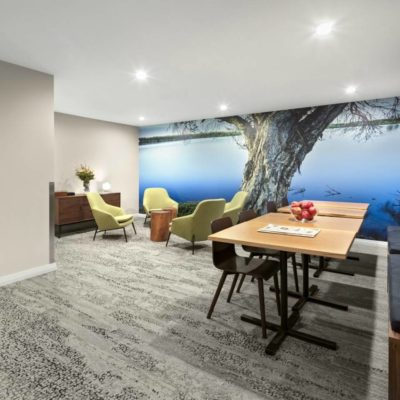Business Lounge In A Hotel Shows Stylish Tables And Chairs.