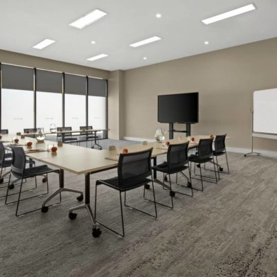 Meeting Room Set Up For A Meeting With Tables, Desks And A Whiteboard.