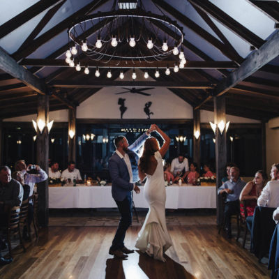 A Bride And Groom Dancing After Their Wedding.