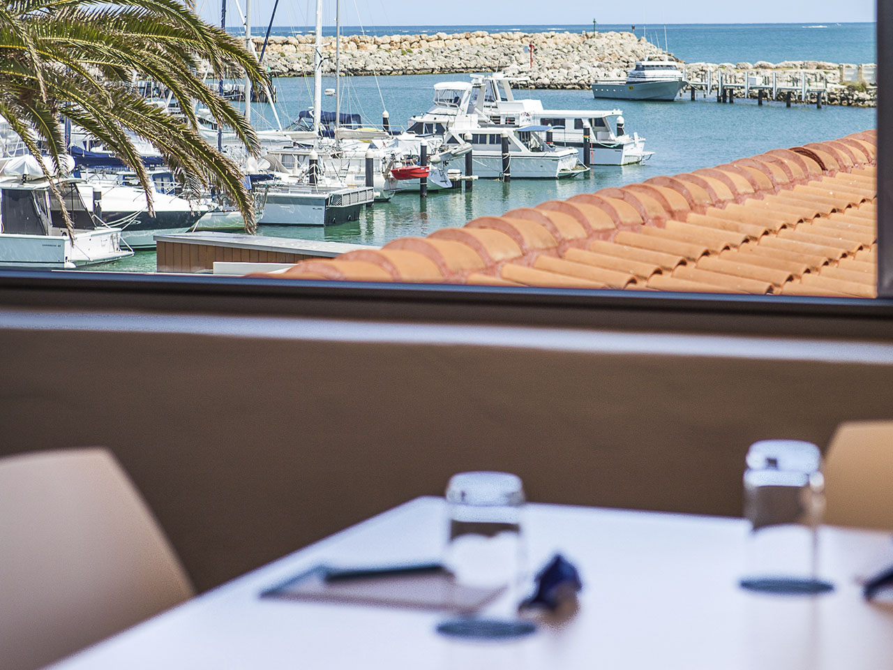 A Table With A View Of The Marina Behind It.