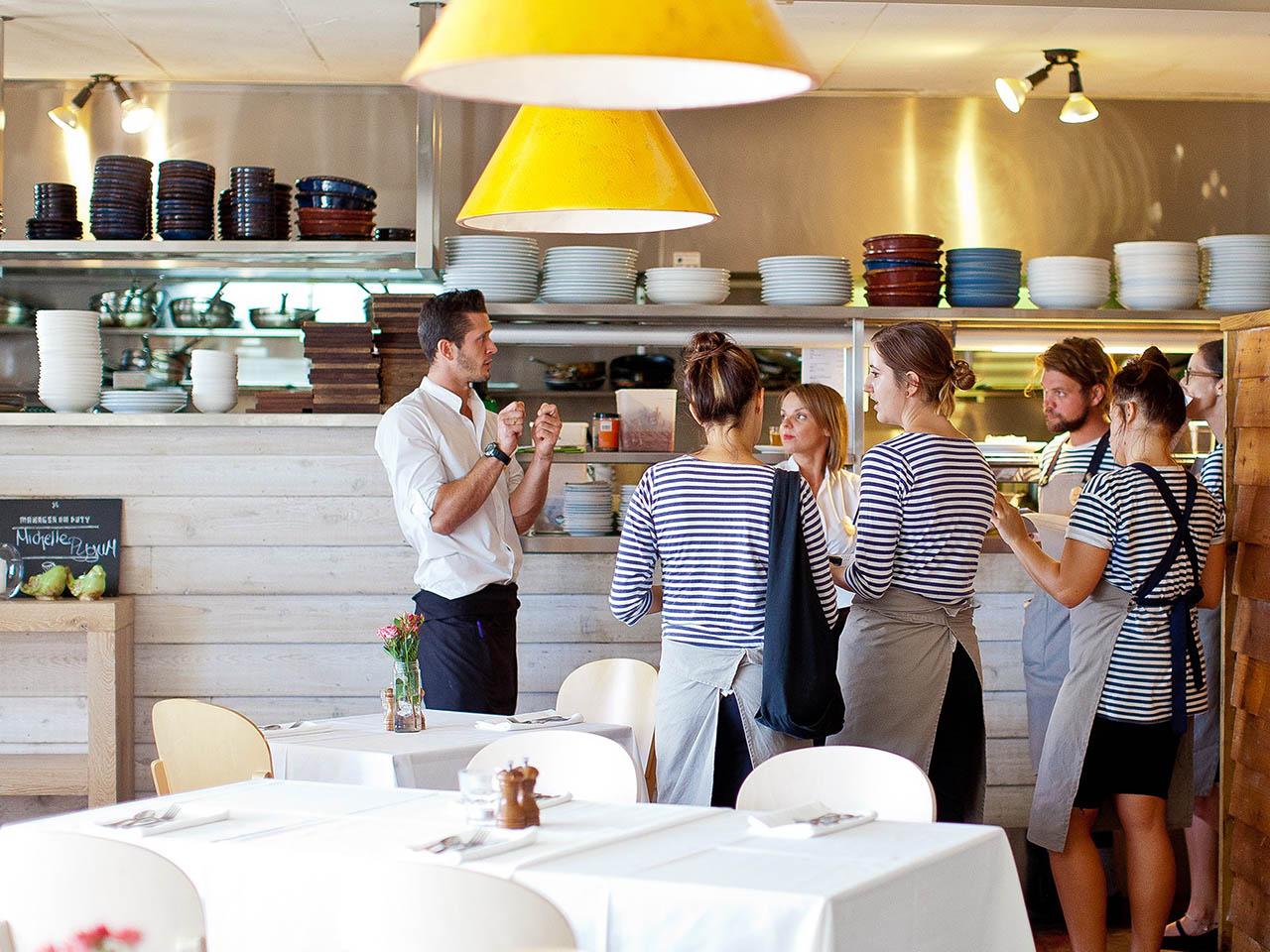 Staffs Having Meeting Inside Voyage Kitchen