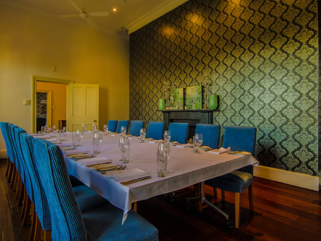Long table set up ready for a boardroom dinner