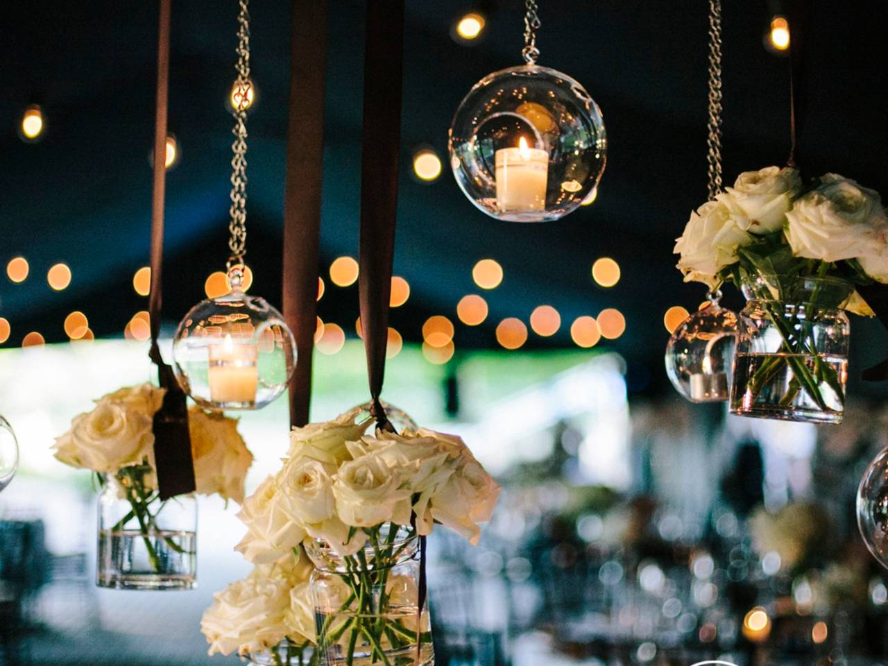 Lights And Flower Decorations At A Marquee Function.