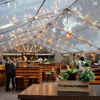 Marquee Dressed And Furnished With Tables And Chairs Ready For An Event.