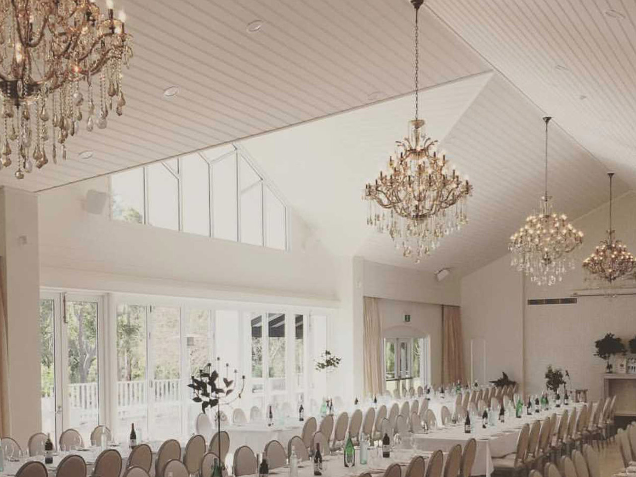Inside the Events Room with Long Tables Setup for Wedding with Chandeliers