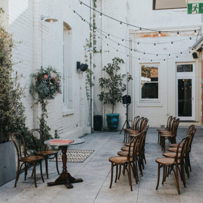 Chairs set up in a courtyard for an intimate wedding ceremony