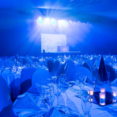 Banquet Style Inside The Ballroom With Stage.