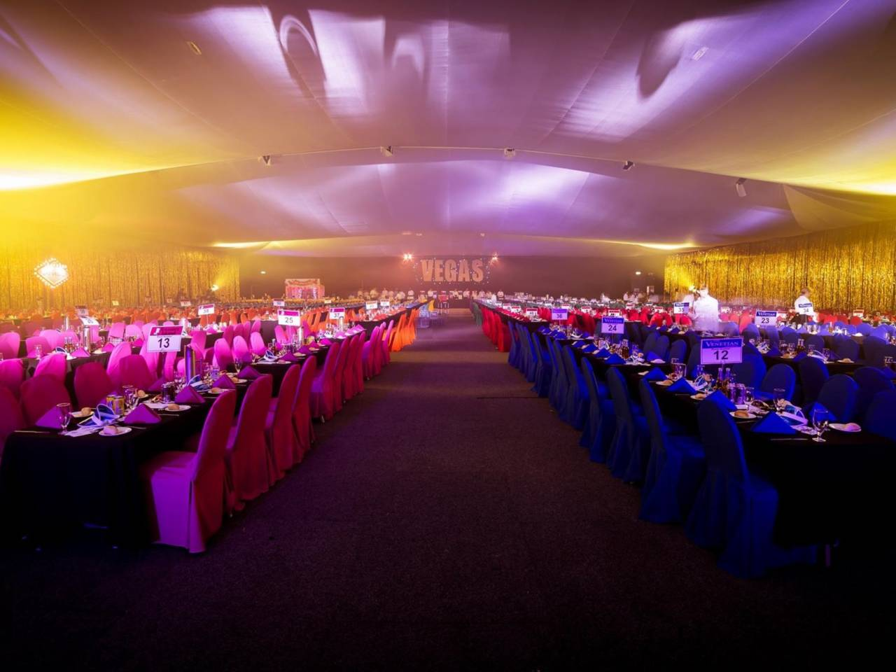 Long Tables Set Up For A Large Event.