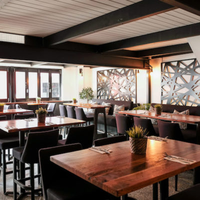 Inside the Restaurant with Chairs and Tables and centerpieces for venue hire