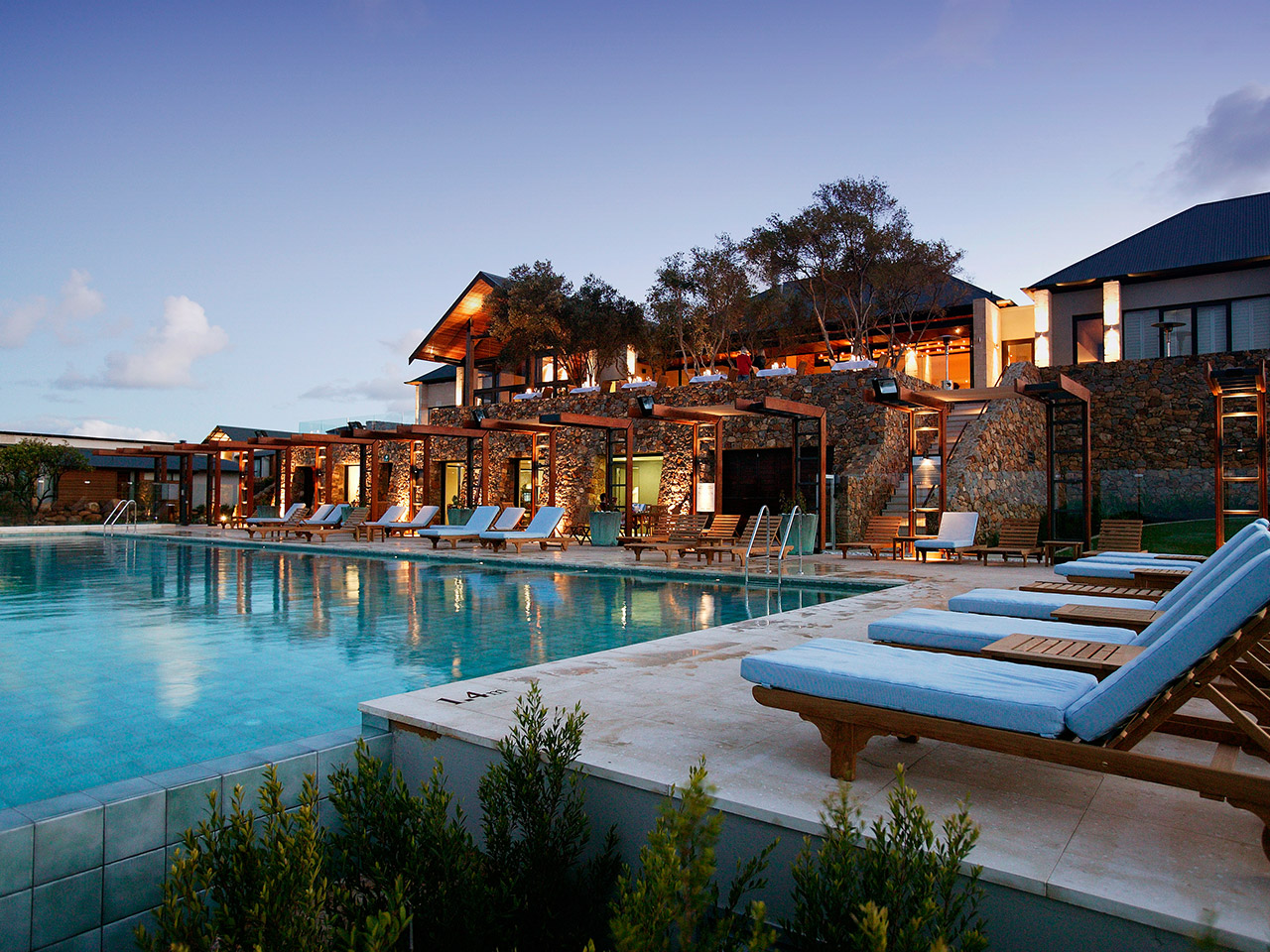 Hotel Building And Swimming Pool At Dusk.