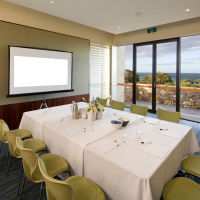 Meeting Room With TV Screen And Ocean Views.