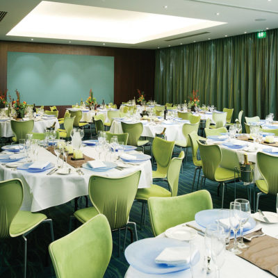 Inside Function Room With Tables And Chairs Set Up.