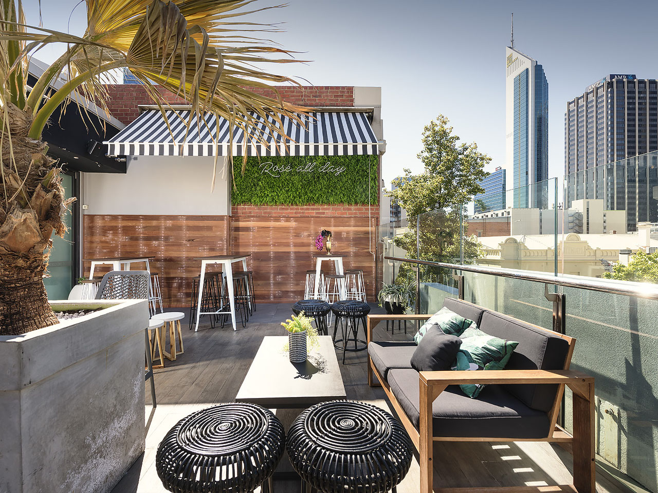 rooftop bar view of city with lounger