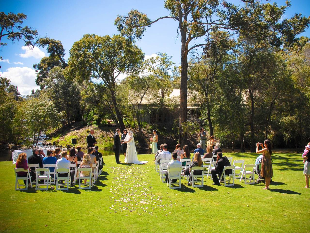 Wedding Ceremony On The Lawn Outside The Building