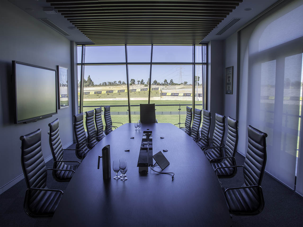 Boardroom Style Table And Chairs With View Across The Sports Oval