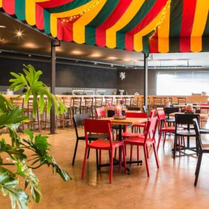Inside the Function Room With Carnival Ceiling Design, String Lights, Chairs And Tables