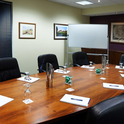 Small Function Room with Whiteboard, Wall Paintings, Table and Chairs in Boardroom Style