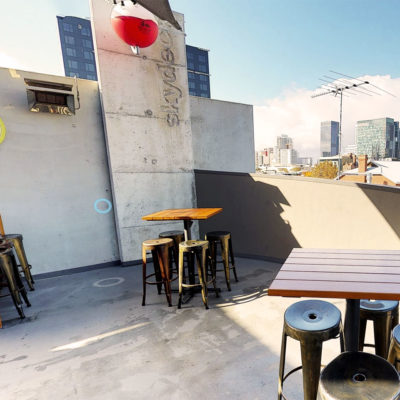 rooftop view of perth with tables in forground