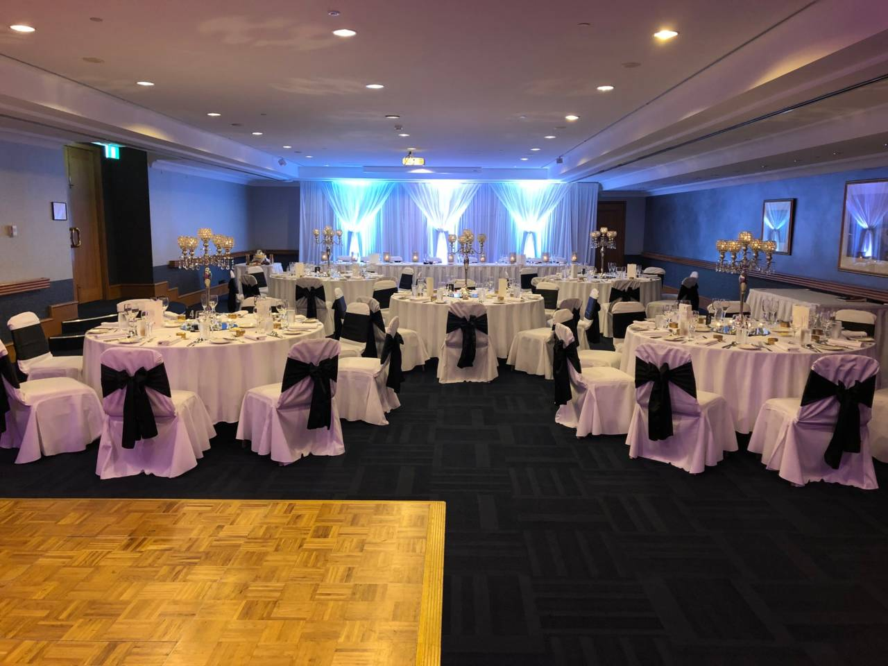 Venue Set Up With Tables And Chairs For a Wedding Function