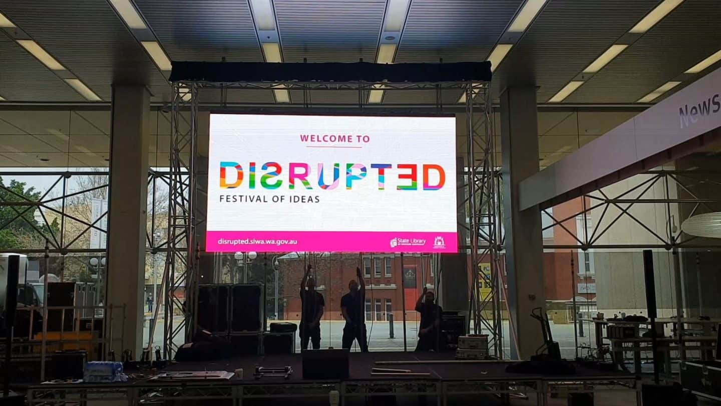 2 Men Hanging The Screen TV With Disrupted Event Sign