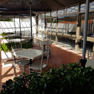 Chairs And Tables In The Alfresco With Green Plants
