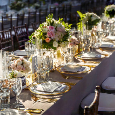 Long Table Wedding Setup With Flower Centerpieces And Decors