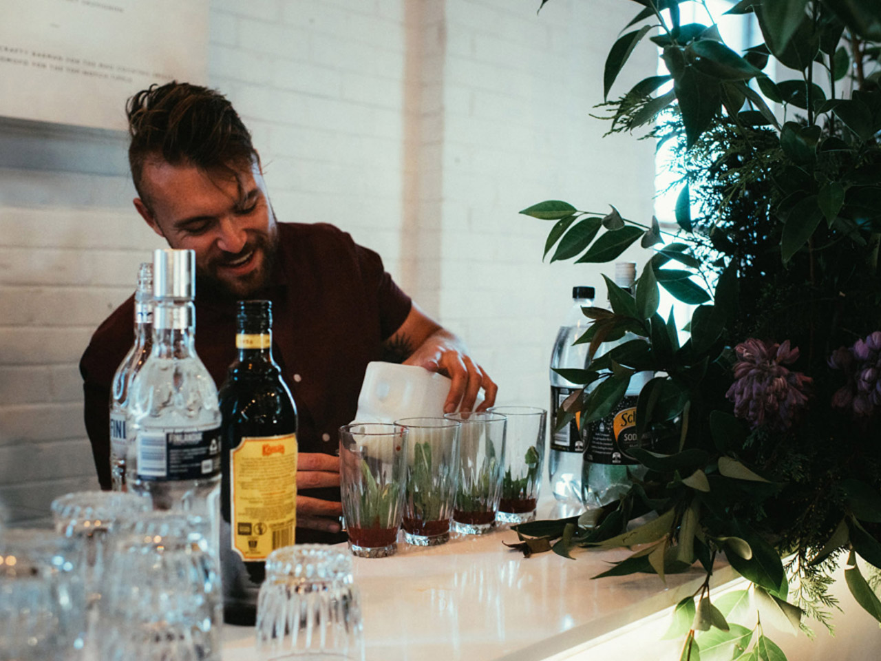 A Man Pouring Drinks In Glasses