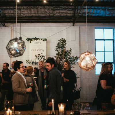 People Gathered Inside The Function Room With Hanging Lights