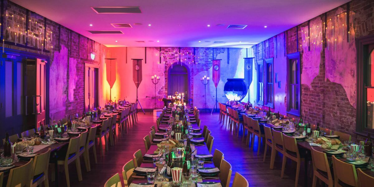 3 Long Tables With Chairs Setup For An Event Inside The Colorful Function Room
