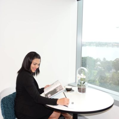 Woman Sitting At A Small Table In A Consulting Room